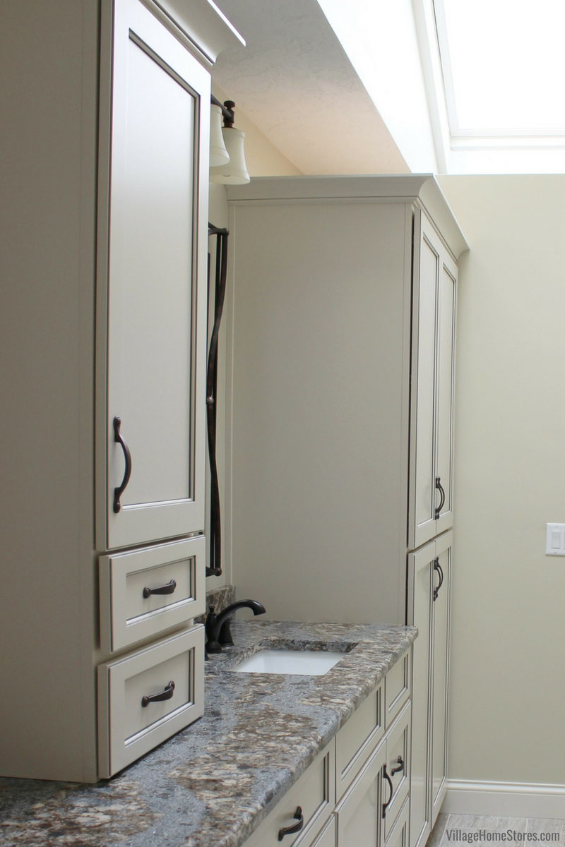 Bathroom storage ideas in a Bettendorf Iowa home remodeled from start to finish by Village Home Stores. | VillageHomeStores.com