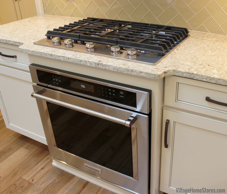 Wall #oven built into base cabinet with Gas #cooktop above. KitchenAid appliances by Village Home Stores. | VillageHomeStores.com