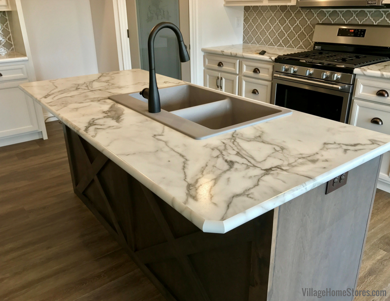 Formica laminate top in Calacatta Marble color with full wrap edge. Colona Illinois New Home by Hazelwood Homes with design and materials from Village Home Stores. | villagehomestores.com
