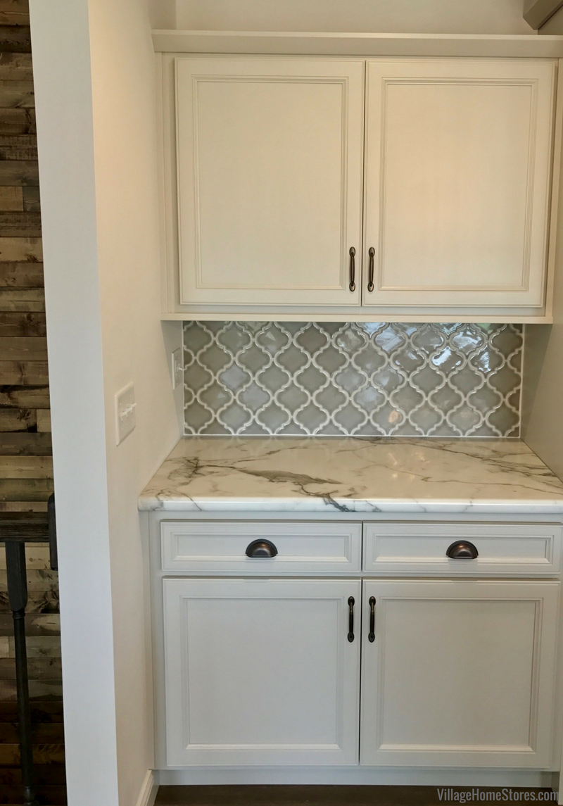 Koch Express cabinets in painted Oyster finish. Colona Illinois New Home by Hazelwood Homes with design and materials from Village Home Stores. | villagehomestores.com