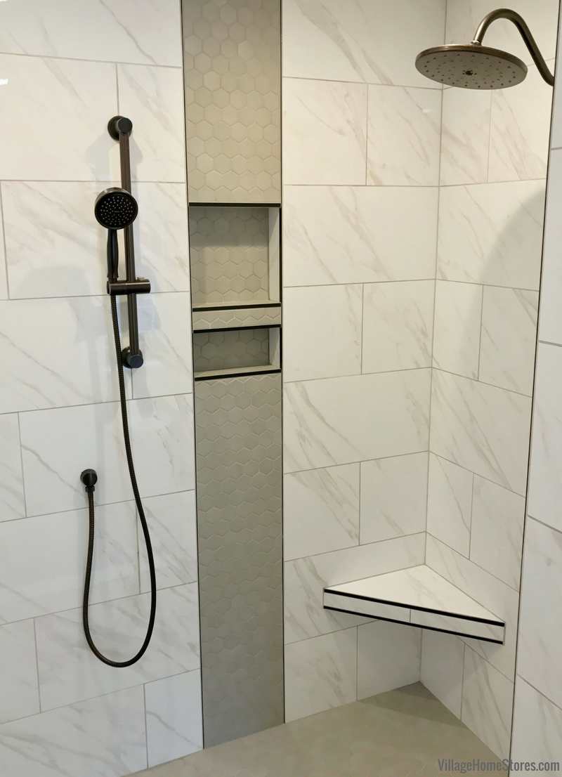 Tiled shower in Quad Cities area home by Hazelwood Homes with design and materials from Village Home Stores. | villagehomestores.com