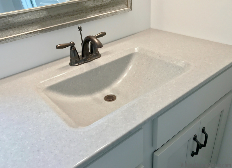 Colona Illinois New Home by Hazelwood Homes with design and materials from Village Home Stores. Onyx Collection vanity top with wave bowl shape. | villagehomestores.com