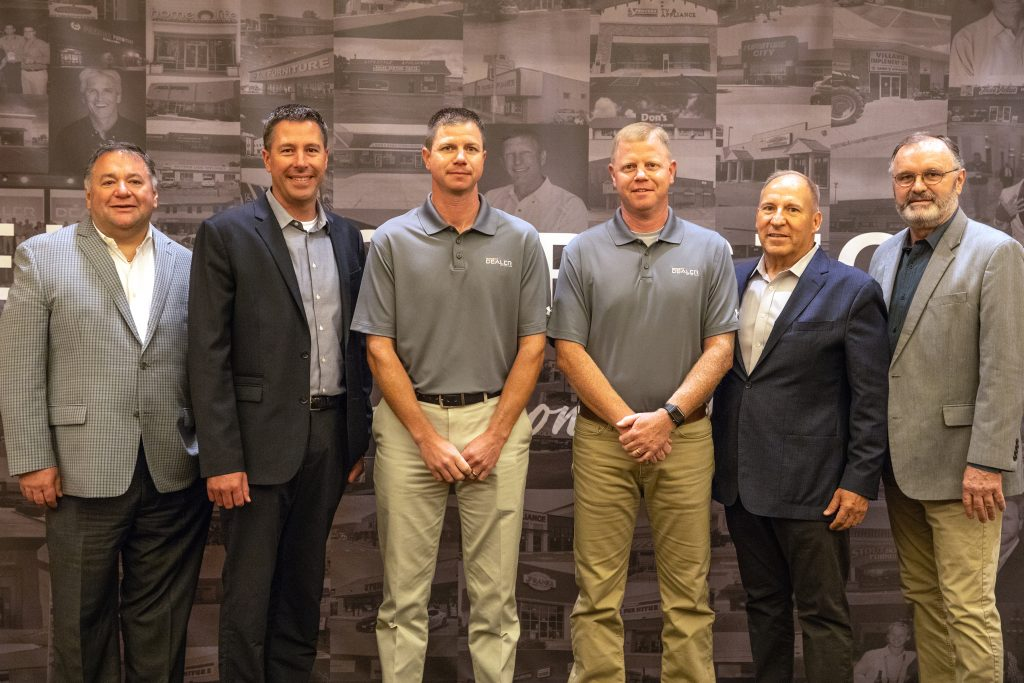 Co-owners of Village Home Stores, Rob Ries and Jim Ries were on hand to receive the honor of being named a 2018 BrandSource Dealer of the Year. | villagehomestores.com