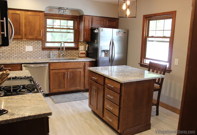 Moline Illinois kitchen with Nevasca Mist granite, Koch Cabinetry, luxury vinyl floors, and mosaic tile. Remodeled from start to finish by Village Home Stores. | villagehomestores.com