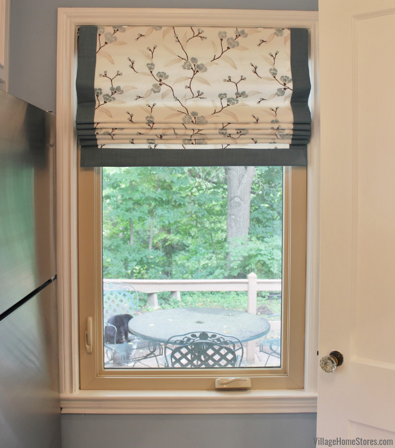 Fabric window shade custom ordered and installed by Village Home Stores in a Muscatine, Iowa home. | villagehomestores.com