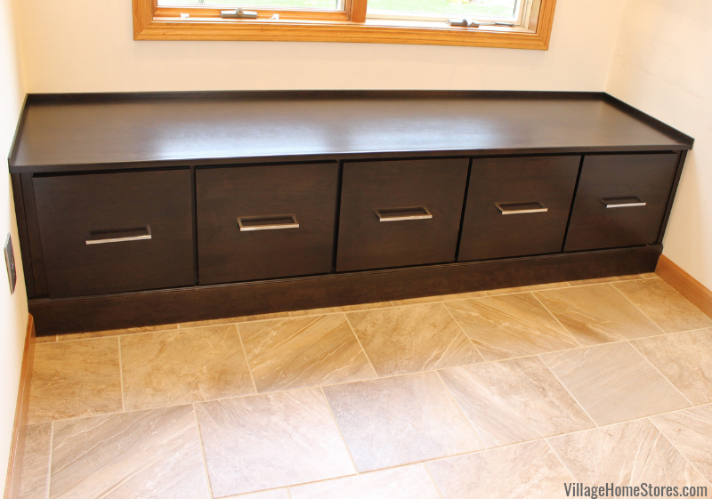 Cherry bench cabinetry with wood top by Dura Supreme in a Moline, IL bathroom remodeled from start to finish by Village Home Stores. | villagehomestores.com