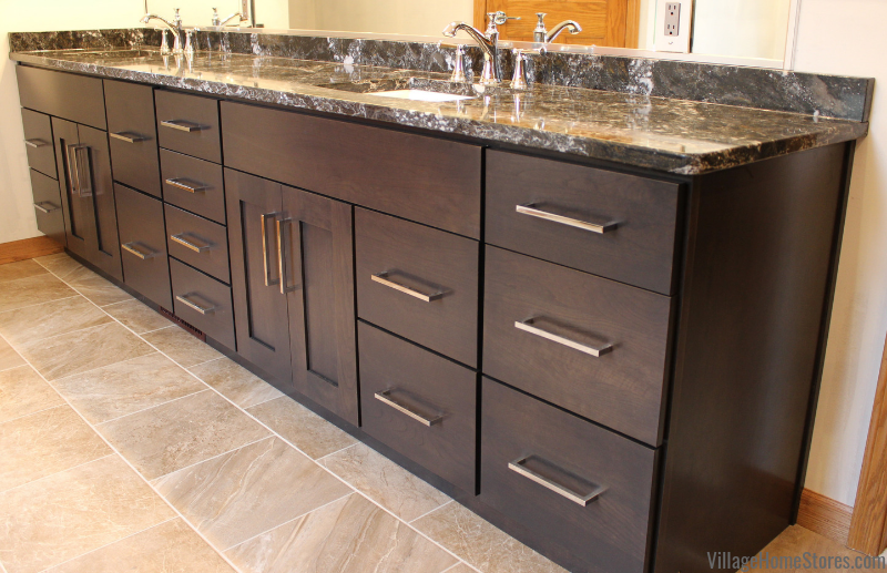 Cherry Peppercorn double vanity cabinetry by Dura Supreme in a Moline, IL bathroom remodeled from start to finish by Village Home Stores. | villagehomestores.com