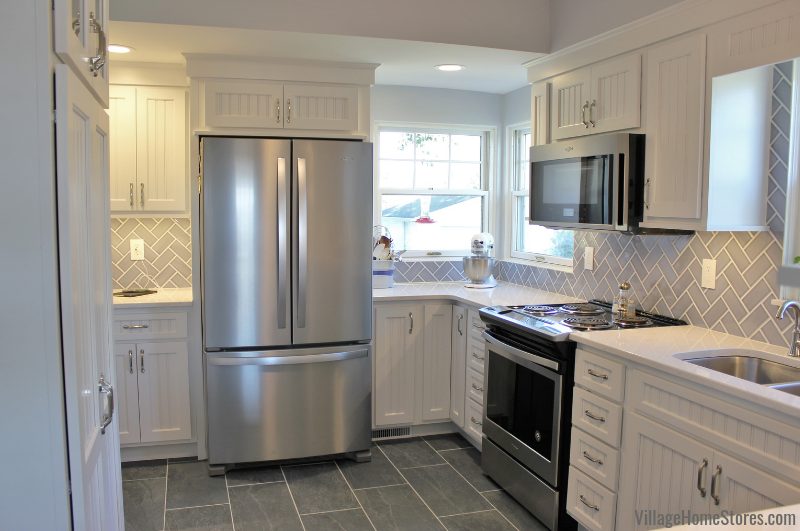 Koch cabinetry, Cambria Swanbridge quartz, and Whirlpool appliances in a Geneseo kitchen. Complete remodel from start to finish by Village Home Stores. | villagehomestores.com