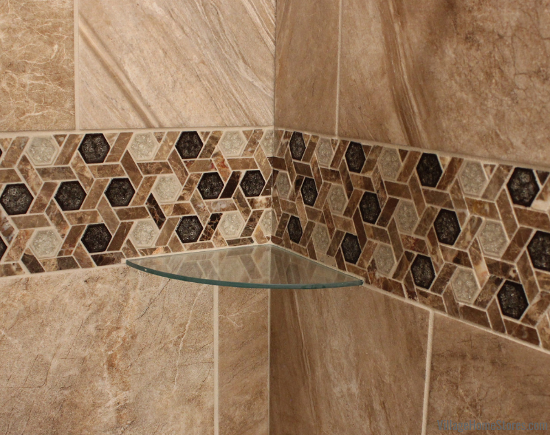 Tiled shower with a glass corner shelf in a Moline, IL bathroom remodeled from start to finish by Village Home Stores. | villagehomestores.com