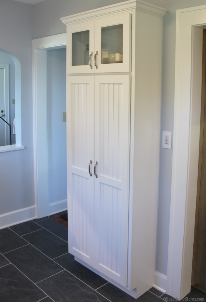 narrow pantry cabinet in a remodeled kitchen from Village Home Stores.