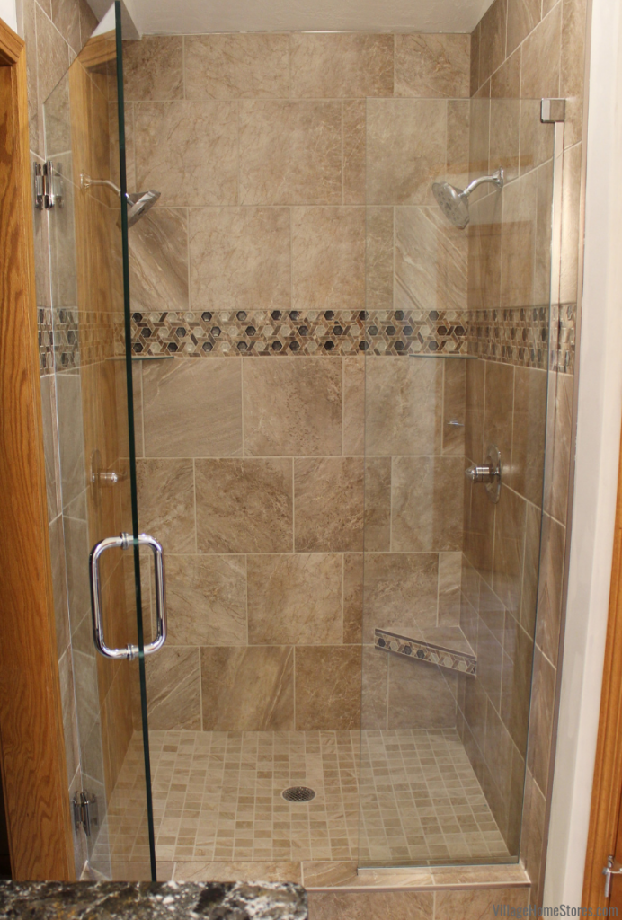 Double shower in a Moline, IL bathroom remodeled from start to finish by Village Home Stores. | villagehomestores.com