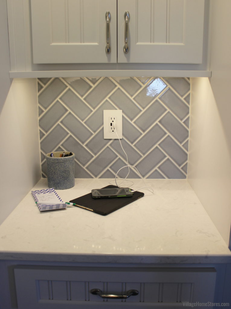 Glazzio's Lumiere series subway tile in gray blue Eiffel Grey color. Legrand Radiant wall outlet with USB charging features no visible screws in a Geneseo farmhouse kitchen. | VillageHomeStores.com
