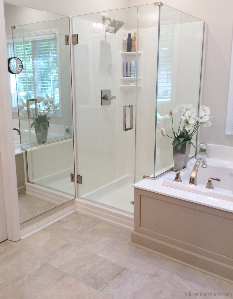 Remodeled bathroom with tub and shower in Bettendorf, Iowa. | villagehomestores.com