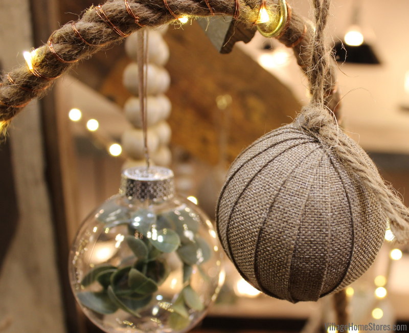 Burlap Christmas idea! Wrap ornaments in burlap strips for your tree. | villagehomestores.com