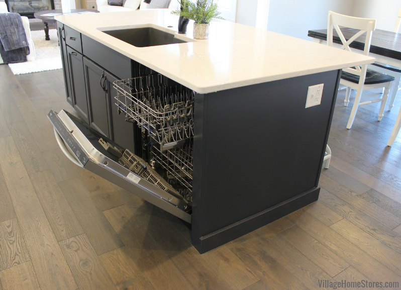 Charcoal Blue painted kitchen island and Whirlpool dishwasher in a Bettendorf, Iowa home. Design and materials by Village Home Stores for Edgebrooke Homes. | villagehomestores.com