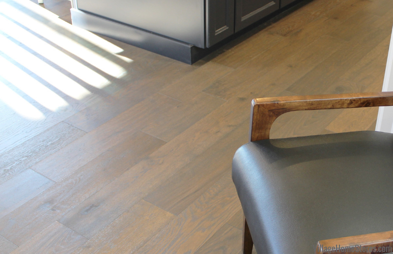 Engineered Oak flooring in a Bettendorf, Iowa home. Design and materials by Village Home Stores for Edgebrooke Homes. | villagehomestores.com