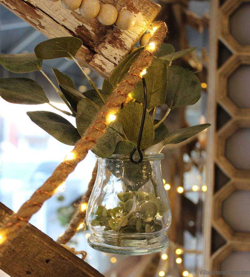 Eucalyptus Christmas idea! Take clear lanterns and hang from your tree with small bouquets of greenery. | villagehomestores.com