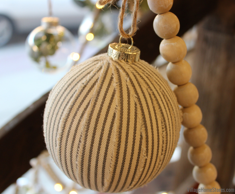 Farmhouse Christmas idea! Wrap ornaments in fabric strips for your tree. | villagehomestores.com