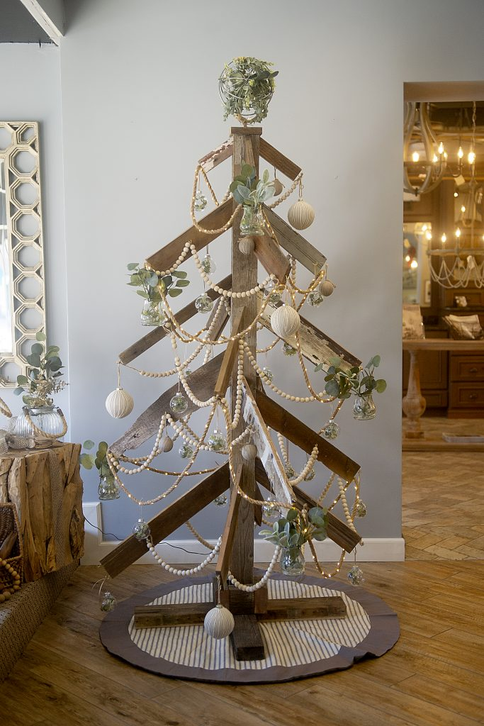 Wooden barnwood Christmas tree built by Durian Builders and Village Home Stores for the Geneseo Giving Trees event to benefit Rebuilding Together Henry County. | villagehomestores.com