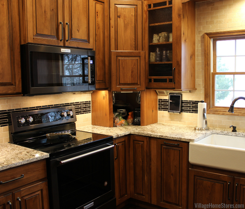 A rural Kewanee kitchen gets a warm new look and an appliance garage. Koch Rustic Beech cabinetry and White Sand Granite featured. | villagehomestores.com
