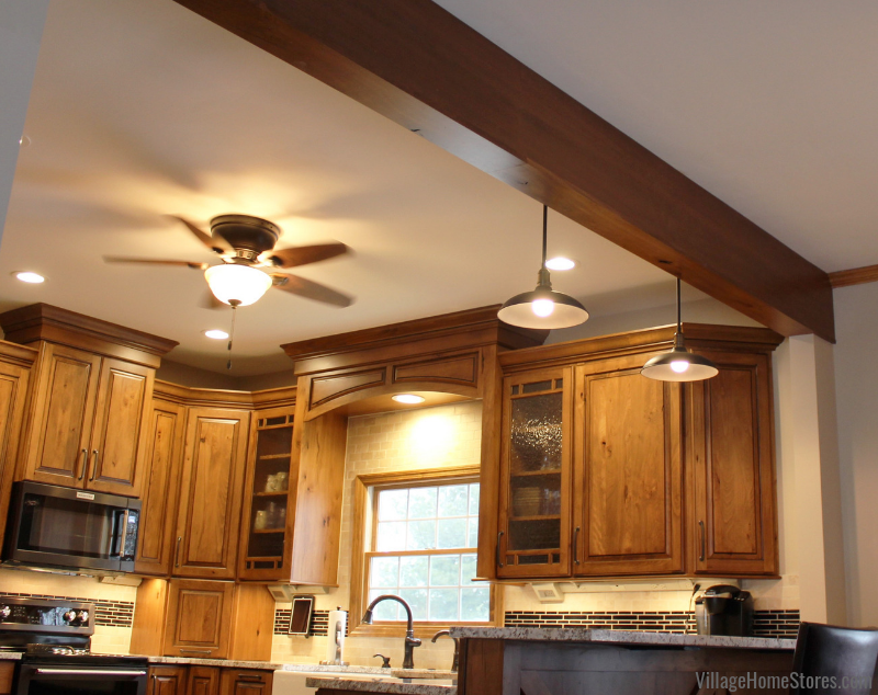 A rural Kewanee Illinois kitchen with a wrapped support beam at ceiling. Rustic kitchen remodel from start to finish by the Project Management team at Village Home Stores. | villagehomestores.com