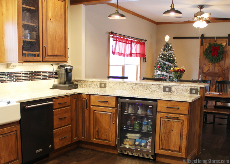 A rural Kewanee kitchen with a peninsula gets a warm new look. Koch Rustic Beech cabinetry and White Sand Granite featured. | villagehomestores.com