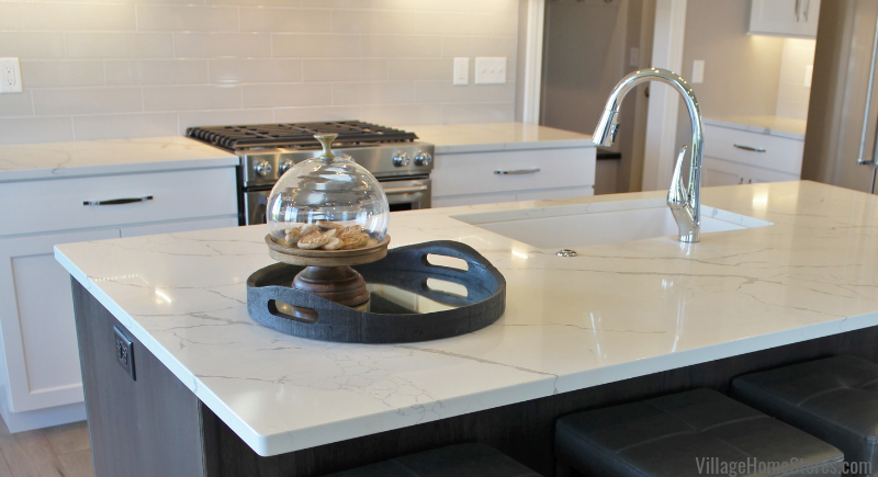 Promotional priced quartz counters available for the extended Quad Cities Region from Village Home Stores Shown: Calacatta Laza in a Bettendorf, Iowa kitchen. | villagehomestores.com