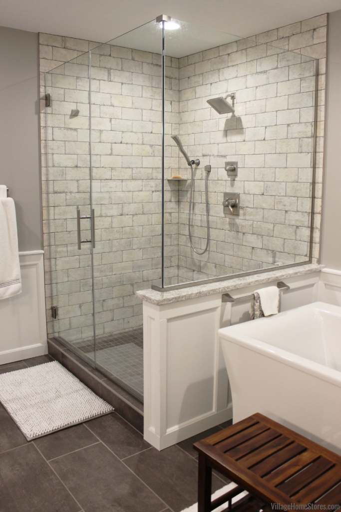 Custom tiled shower installed in a remodeled Bettendorf Iowa bathroom. Bathroom remodel from start to finish by Village Home Store | villagehomestores.com