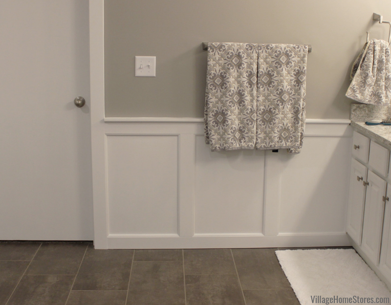 Custom wainscot paneling installed in a remodeled Bettendorf Iowa bathroom. Bathroom remodel from start to finish by Village Home Stores. | villagehomestores.com