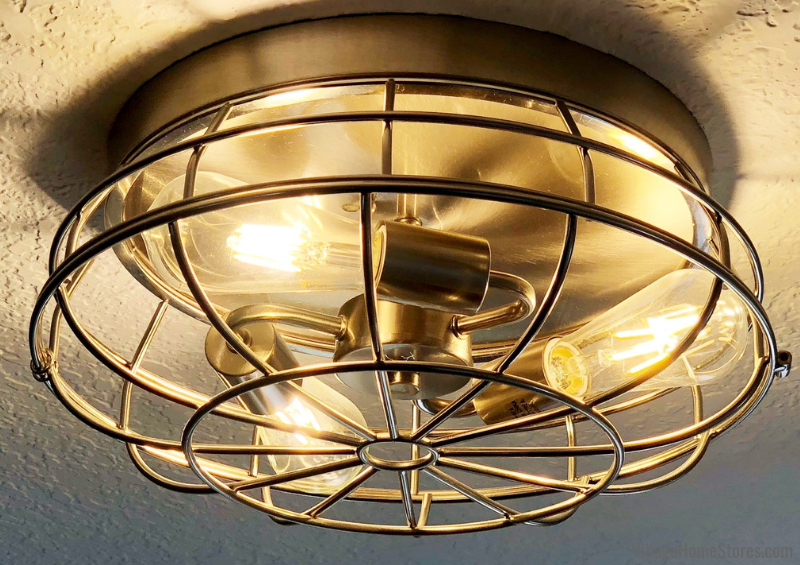 Caged style light fixture in a Geneseo, IL kitchen. Lighting by Village Home Stores for Hazelwood Homes. | villagehomestores.com