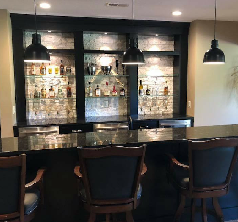 Home Bar cabinetry and Granite by Village Home Stores. Photo and home by Heartland Builders of the Quad Cities.
