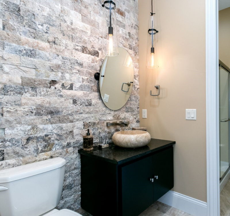 Custom floating bath vanity with vessel sink and Cambria Quartz by Village Home Stores. Photo and home by Heartland Builders of the Quad Cities.
