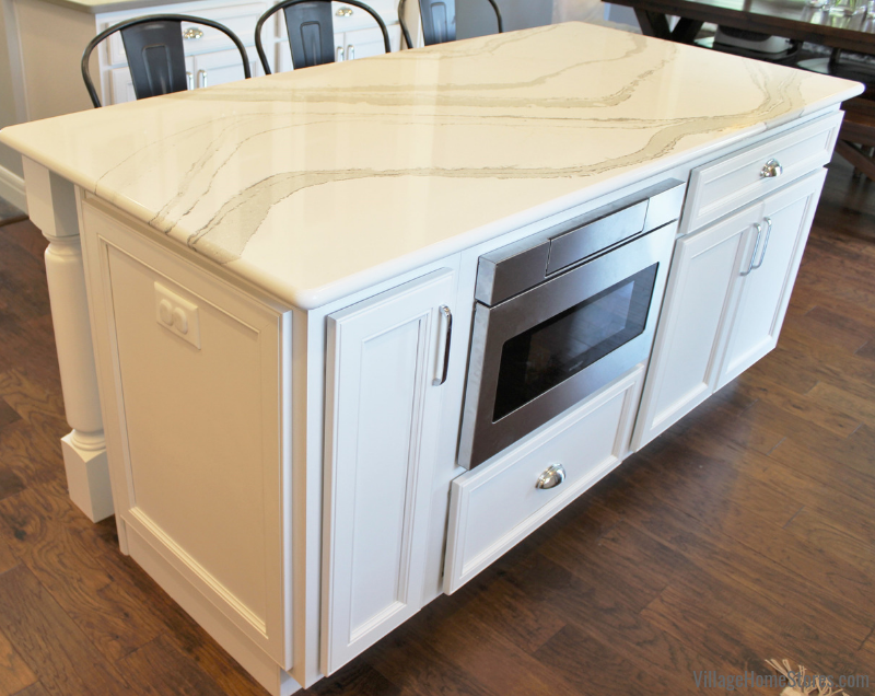 Microwave drawer with hidden controls installed in a Quad Cities Area kitchen island. Kitchen design, materials and appliances by Village Home Stores. | villagehomestores.com