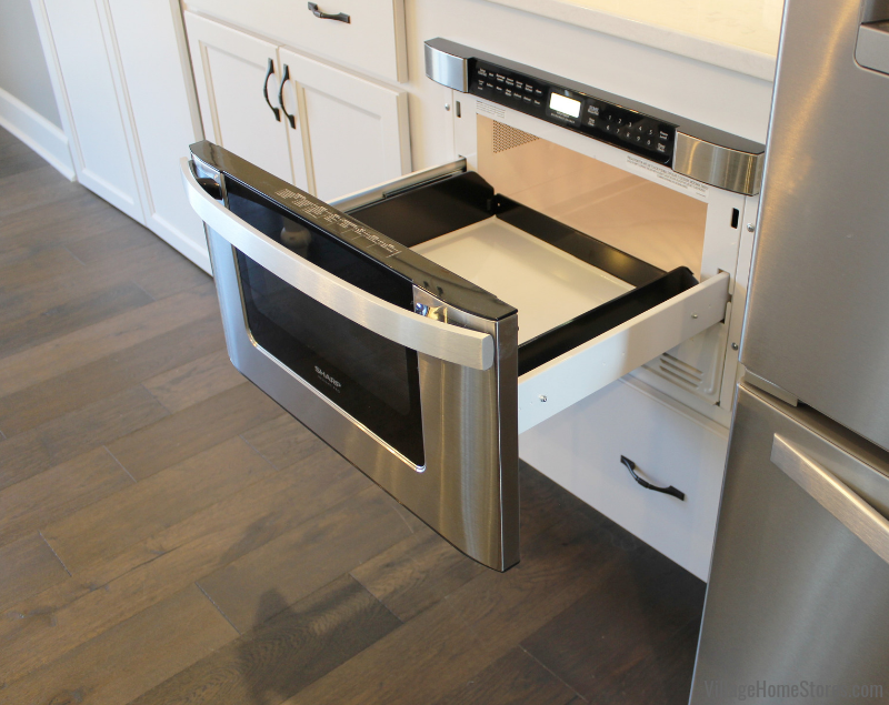 Sharp microwave drawer with handle in a Bettendorf, Iowa kitchen. Sharp appliances available at Village Home Stores. | villagehomestores.com
