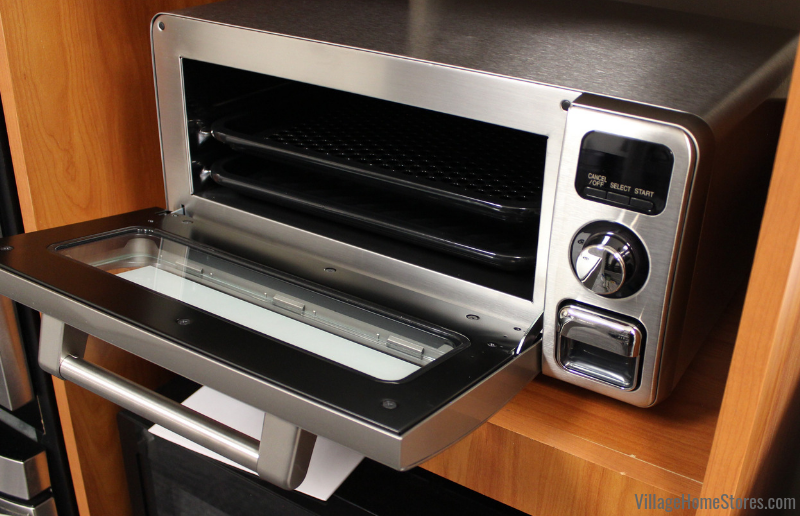 "Sharp Steam Toaster Oven that can toast, broil/grill, bake/re-heat, warm, and fit a 12"" pizza! Available at Village Home Stores. 