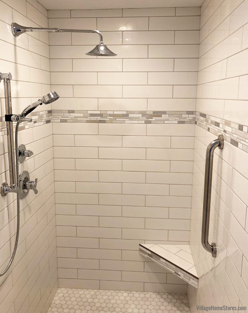 tiled shower in a Geneseo, IL bathroom. Tile by Village Home Stores for Hazelwood Homes. | villagehomestores.com