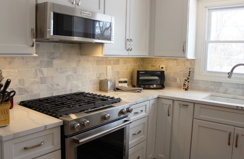 Subway tile backsplash in Ababescato Carrara marble. Complete kitchen remodels from start to finish. | villagehomestores.com