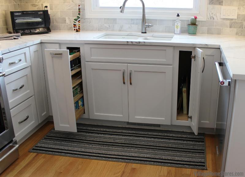 White kitchen cabinets with pullout spice cabinet. Complete kitchen remodel from start to finish by Village Home Stores. | villagehomestores.com