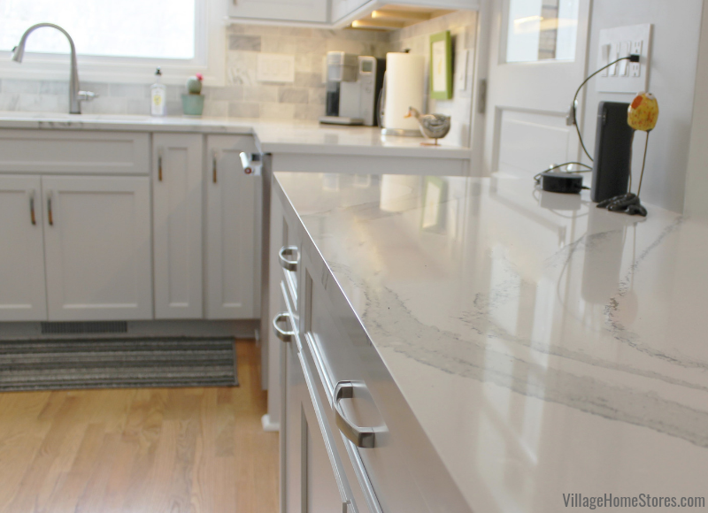 Cambria Britannica quartz counters in a White painted Moline, IL kitchen. Complete kitchen remodel from start to finish by Village Home Stores. | villagehomestores.com