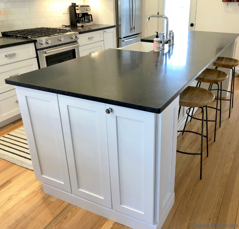 White painted kitchen with Honed Black Granite counters in historic McClellan Heights district of Davenport, IA remodeled from start to finish by Village Home Stores. | villagehomestores.com