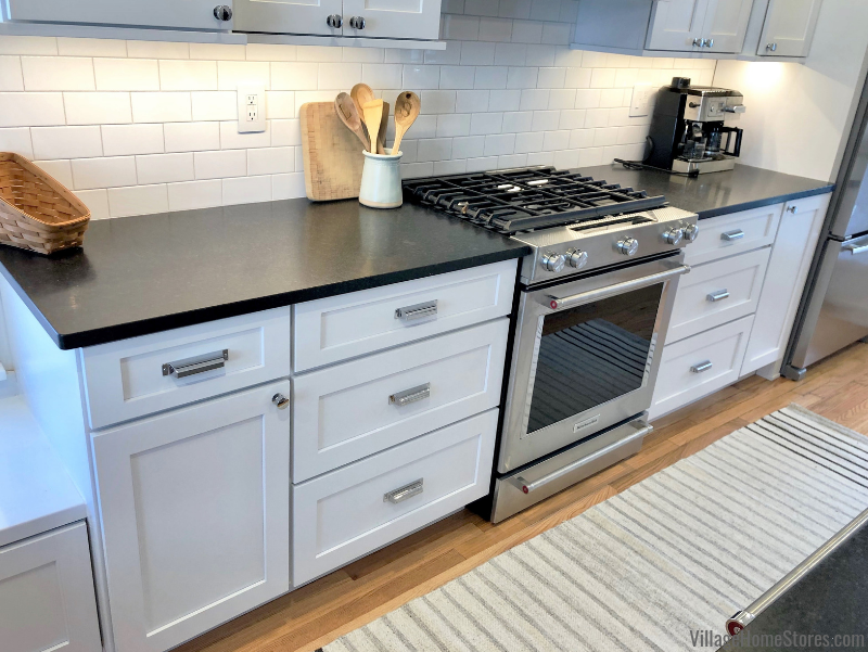 White painted kitchen with subway tile in historic McClellan Heights district of Davenport, IA remodeled from start to finish by Village Home Stores. | villagehomestores.com