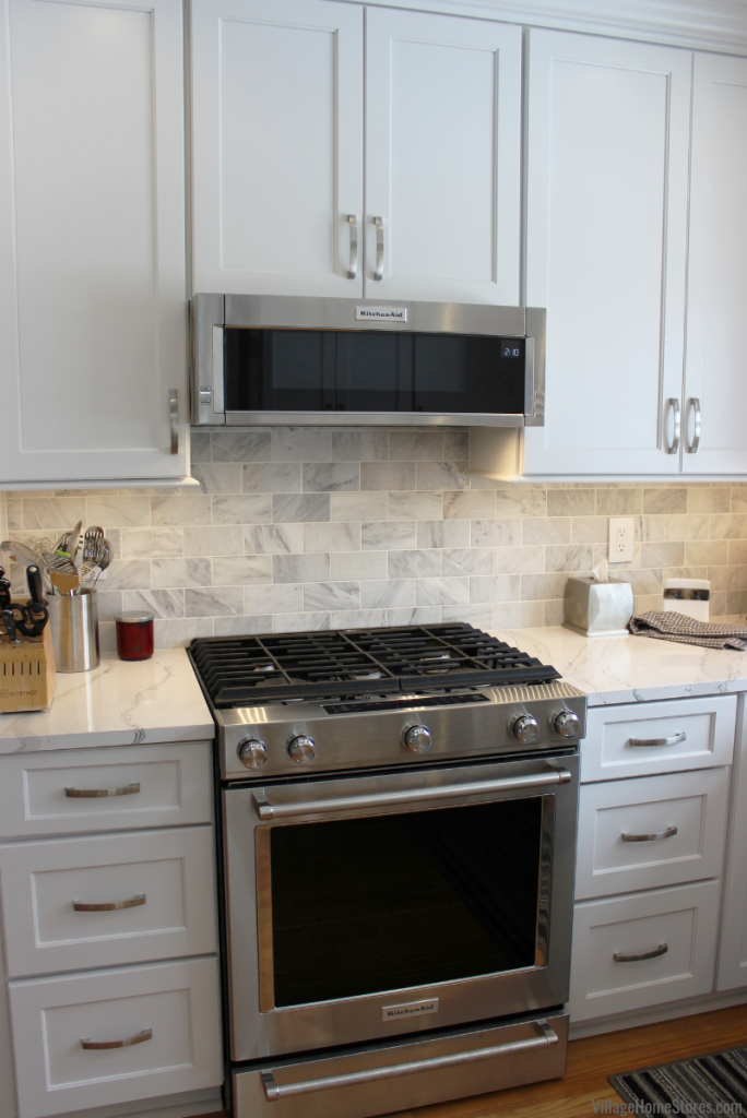 KitchenAid low profile microwave hood and 700ESS gas range in a remodeled Quad Cities kitchen from Village Home Stores. Complete kitchen remodels from start to finish. | villagehomestores.com