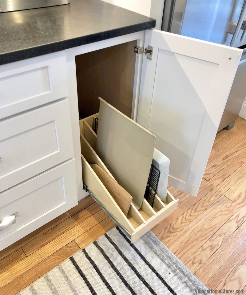 White painted kitchen with pullout tray divider organizer. Kitchen remodeled from start to finish in the McClellan Heights district of Davenport, IA by Village Home Stores. | villagehomestores.com
