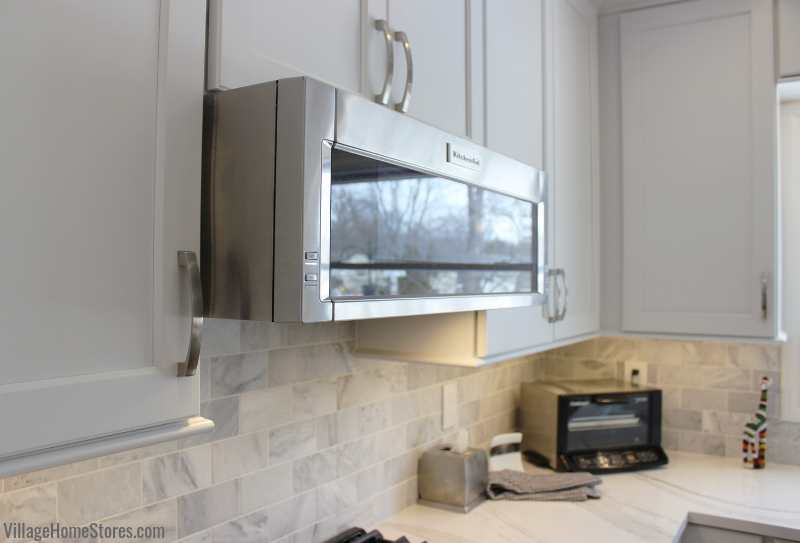 KitchenAid low profile microwave hood in a remodeled Quad Cities kitchen from Village Home Stores. Complete kitchen remodels from start to finish. | villagehomestores.com