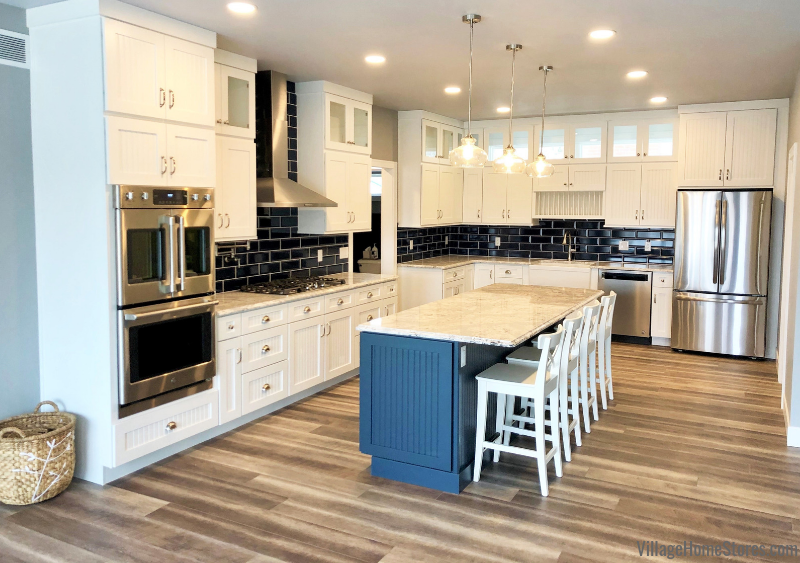 Dura Supreme cabinets in Prophetstown, IL with CoreTec flooring, blue wall tile, and Cambria quartz countertops. Design from Village Home Stores for Hazelwood Homes of the Quad Cities.