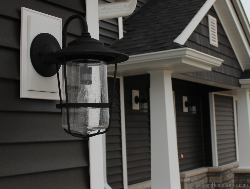 Capitol Creekside Wall Lantern on exterior of Maple Leaf Heights home. Lighting from Village Home Stores for Hazelwood Homes. Geneseo/Quad Cities