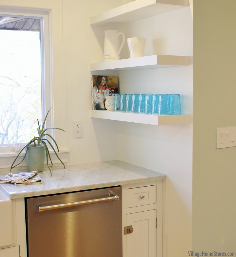 White kitchen with floating wall shelves. Complete kitchen remodel from start to finish by Village Home Stores.