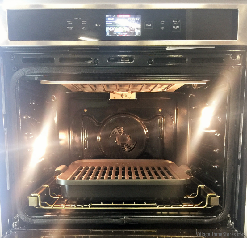 The KitchenAid smart oven with powered attachments allow you to grill year round indoors! The grill coils are covered by the top plate so that grease will not drip down onto the coils to cause smoking. | villagehomestores.com