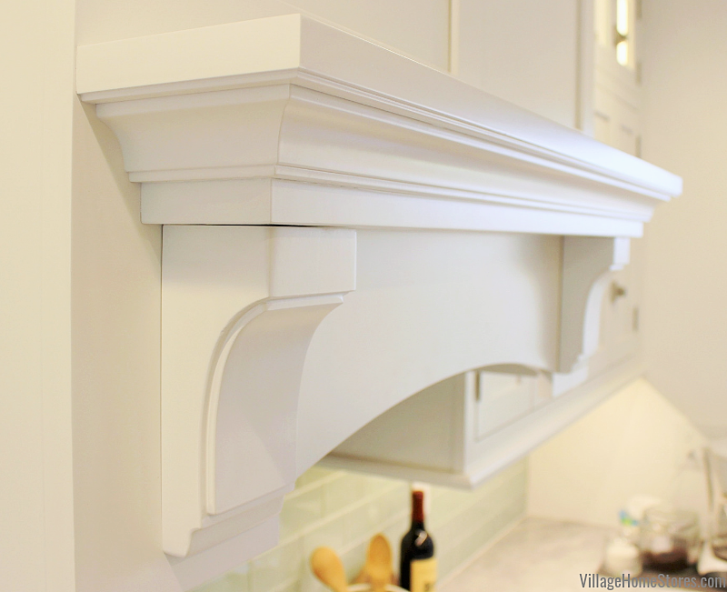 Kitchen wood range hood mantle detail from Dura Supreme. Complete kitchen remodel from start to finish by Village Home Stores.