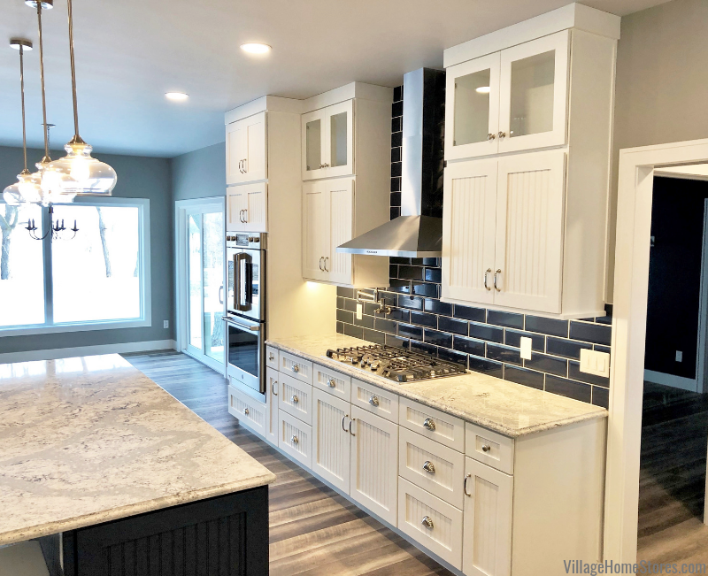 Dura Supreme cabinets in Prophetstown, IL paired with blue wall tile and Cambria quartz countertops. Design by Chris Robinson from Village Home Stores for Hazelwood Homes of the Quad Cities.